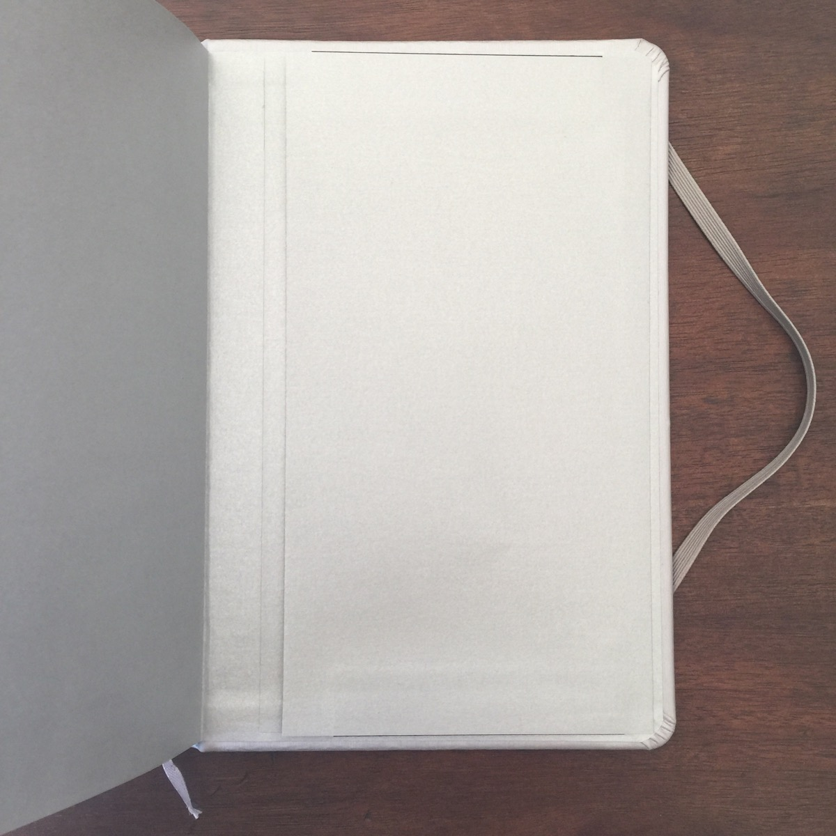 paper review  out a doubt this is a high quality item it is well made and feels luxurious the notebook features all of the bells and whistles hard cover